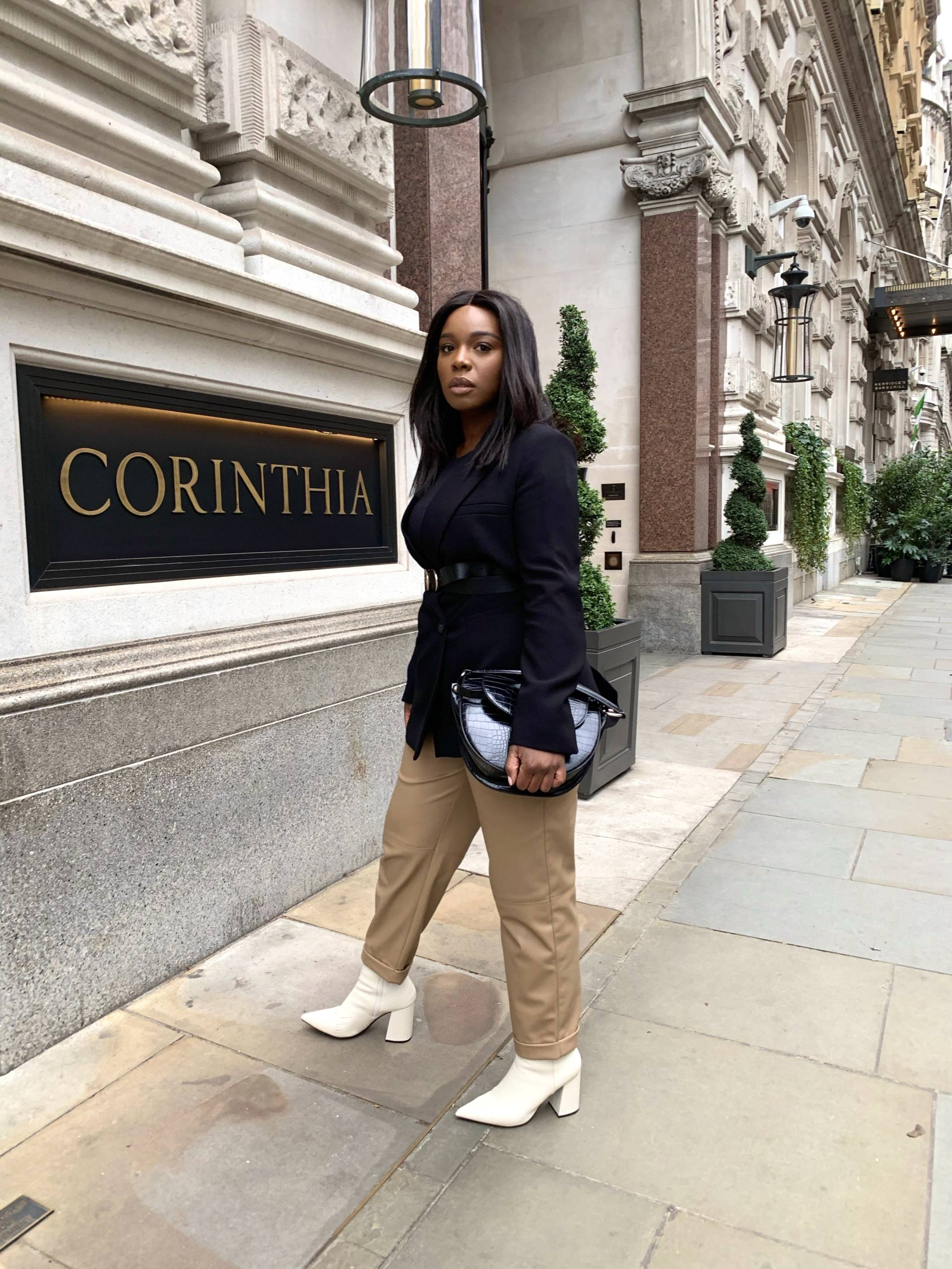 black woman wearing a cream leather trousers in London