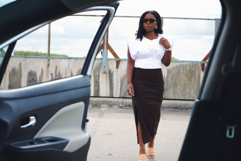 black woman wearing a linen skirt