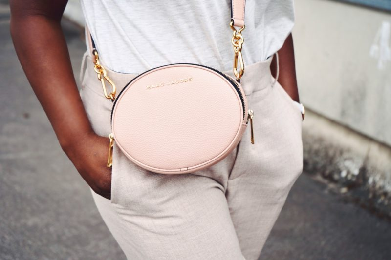 image feature black woman wearing a designer bag
